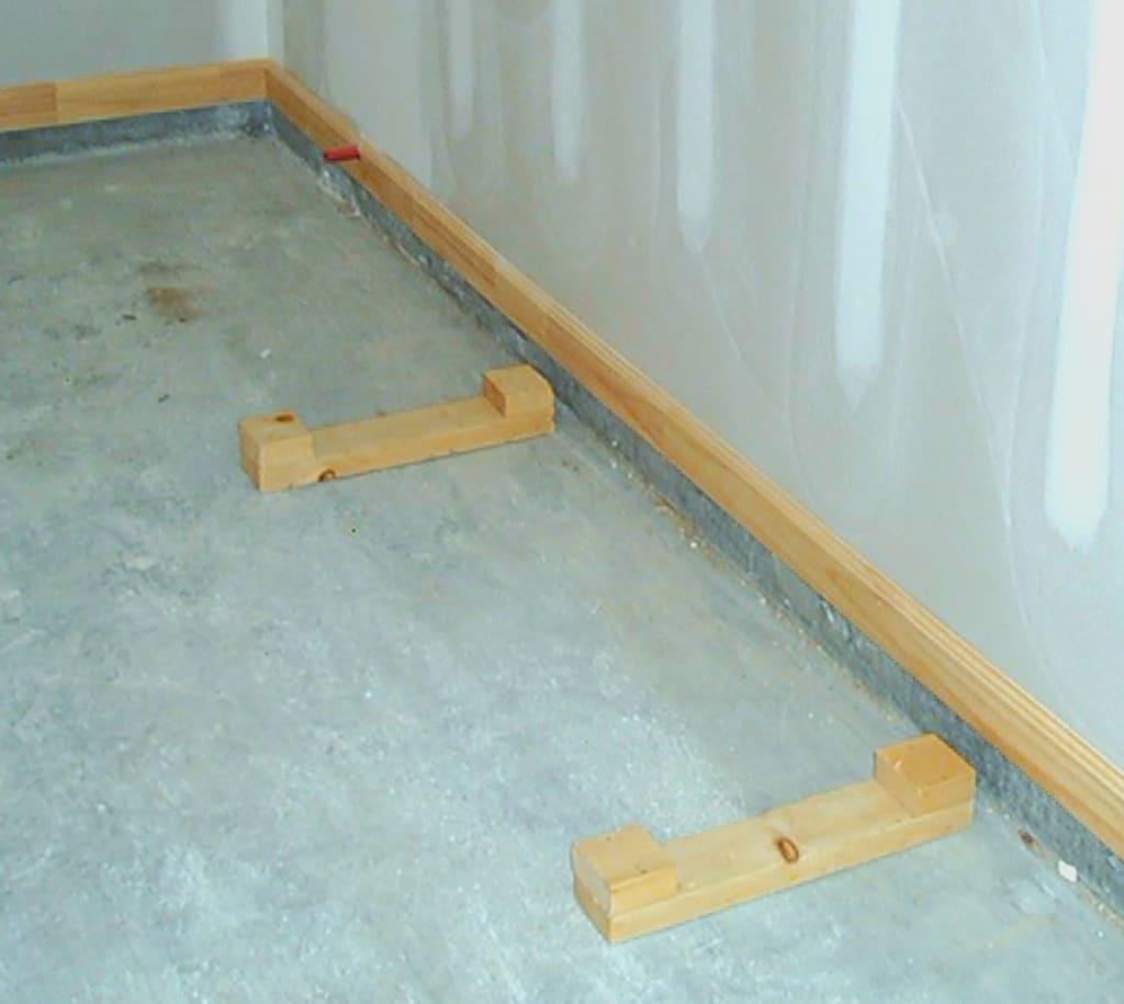 Rack base blocks for hurricane protection plywood panel storage